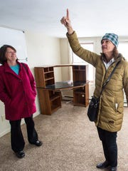 Sisters Brenda, left, and Becky Bouchard explain how they used to crawl up onto the roof to sunbathe as they tour the former Bel-Aire Motel (and their home from 1967 - 1985) on Shelburne Street in Burlington. Photographed Tuesday, March 21, 2017.