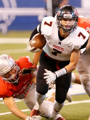 Jordan Owens of Rensselaer with a carry against West Lafayette Saturday, September 16, 2017, at Lucas Oil Stadium in Indianapolis. West Lafayette pounded Rensselaer 55-6.