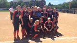 Kennedy's softball team receives the state championship trophy Friday after winning the title game 10-0.