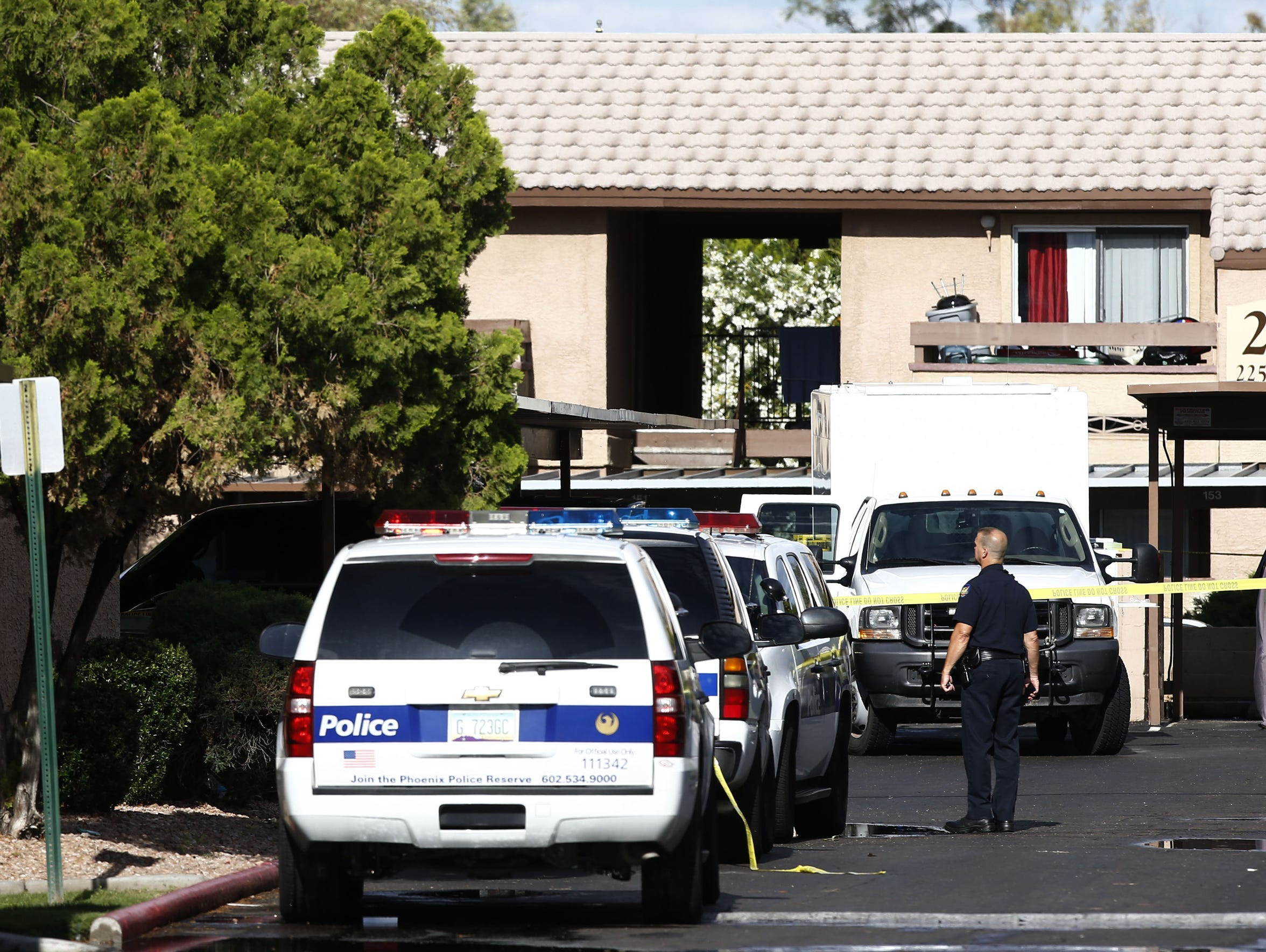 FBI agents search a Phoenix apartment on Monday, May
