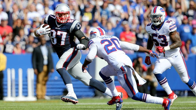 Patriots Rob Gronkowski tries to run past Buffalo's Corey Graham after a catch during the team's first meeting on Sept. 20.