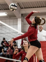 McKenzie Andrix sets the ball to teammate Morgan Meyers