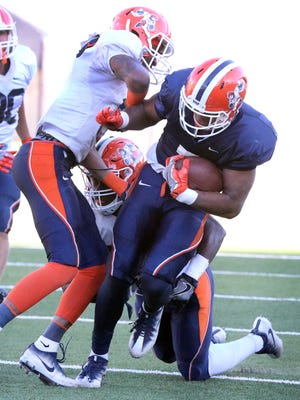 UTEP wide receiver Kavika Johnson scampers past the defense on his way to the end zone during Friday's scrimmage game in the Sun Bowl Stadium.