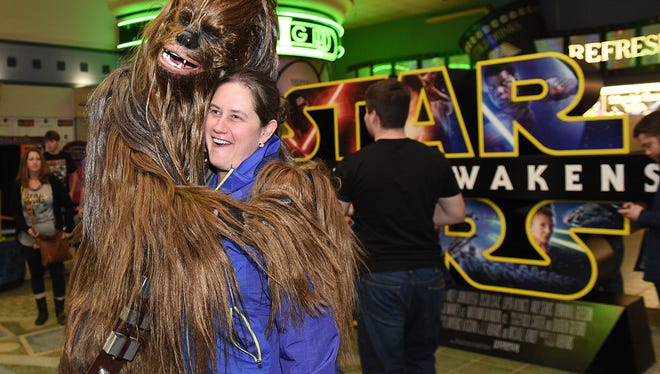 """Star Wars"" fan Christin Anderson of Franklin gets her photograph taken with a Chewbacca character in the lobby at Carmike Thoroughbred 20. The theater was sold for $38 million in 2016."