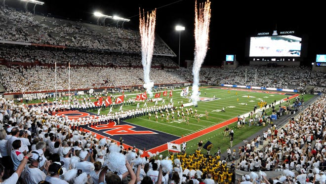 Fireworks go off as the Arizona Wildcats run onto the field before the game against Cal on Sept. 20, 2014, in Tucson.