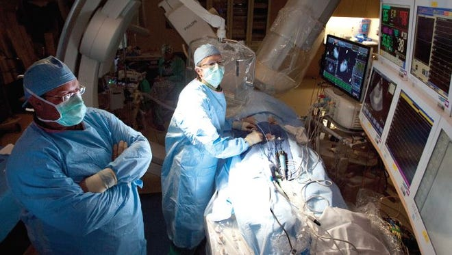 Dr. Russell Heath performs an atrial fibrillation ablation with CARTO mapping system, assisted by Brett Shreve, electrophysiology nurse.