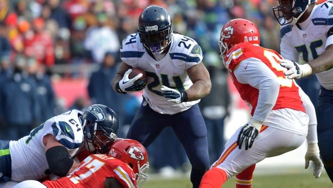 Seattle Seahawks running back Marshawn Lynch (24) runs the ball as Kansas City Chiefs outside linebacker Tamba Hali (91) attempts the tackle during the first half at Arrowhead Stadium. The Chiefs won 24-20.