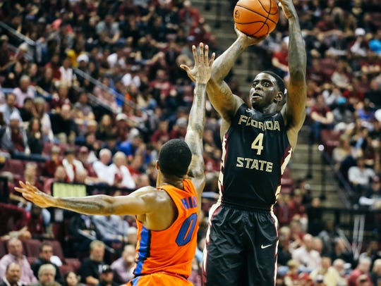 Dwayne Bacon (4) shoots the ball during the second