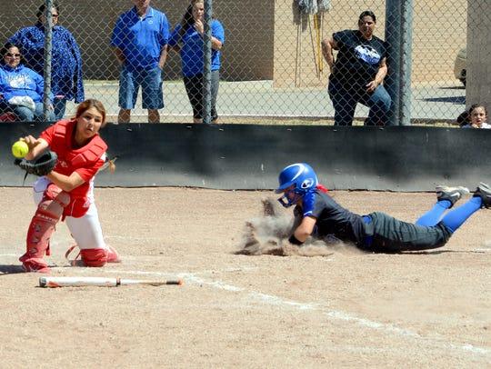 Loving senior catcher Ashlen Sartin tries to grab hold