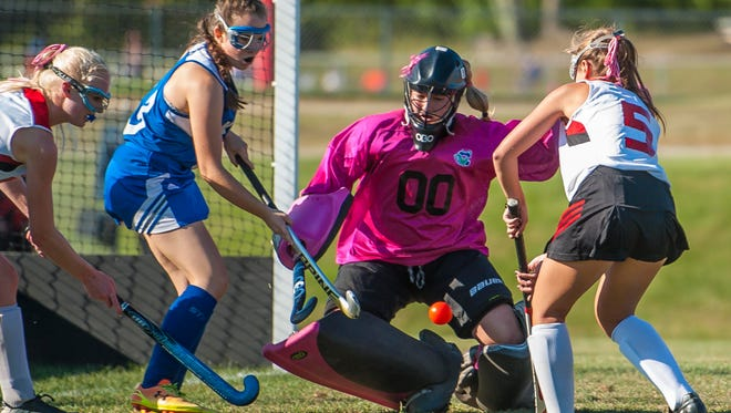 Colchester's Abby Ladd, center, defends the goal against CVU in Hinesburg on Monday, September 13, 2016.