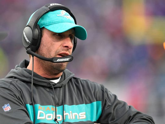 Miami Dolphins head coach Adam Gase watches the first half of an NFL football game against the Buffalo Bills, Sunday, Dec. 30, 2018, in Orchard Park, N.Y. (AP Photo/Adrian Kraus)