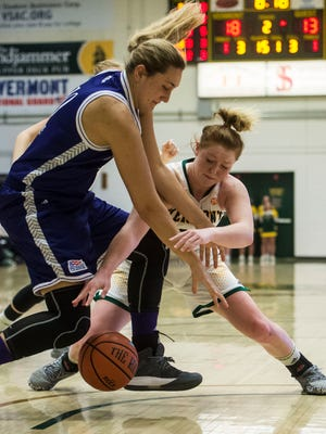 UVM #24 Kallie Banker wrestles with Holy Cross #10 Megan Swords for possession during the University of Vermont women's basketball 63-52 win at Patrick Gymnasium Wednesday night, Nov. 30, 2016.