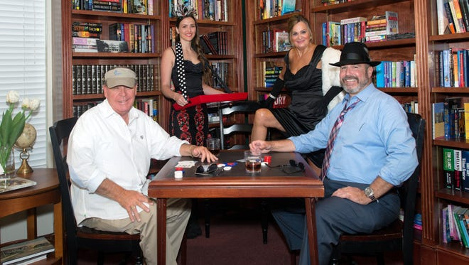 Founder Kevin Sharkey, Wendy Tyo, Dee Gusch and CEO Bill West are ready for Casino Night.