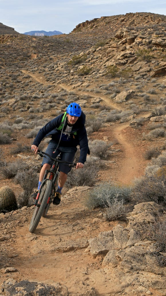Joey Dye rides a mountain bike along the Precipice Trail in the Santa Clara River Reserve.