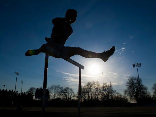 Adrian Kjellen, 17, of Nykšping, Sweden, jumps hurdles
