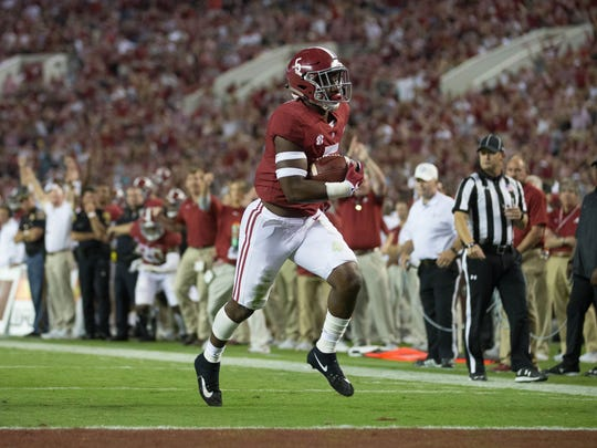 Sep 30, 2017; Tuscaloosa, AL, USA; Alabama Crimson Tide tight end Ronnie Clark (5) carries the ball for a touchdown against the Mississippi Rebels during the fourth quarter at Bryant-Denny Stadium. Mandatory Credit: Marvin Gentry-USA TODAY Sports