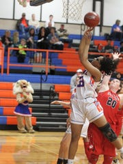 Central High School senior Tay Dosson puts up an acrobatic shot in a District 8-6A basketball game against Belton at Babe Didrikson Gym on Friday, Feb. 2, 2018.