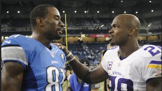 Adrian Peterson (right) speaks to Calvin Johnson after a game in 2015.