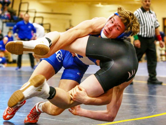 Catholic Central's Derek Gilcher (top) decisioned Woodhaven's