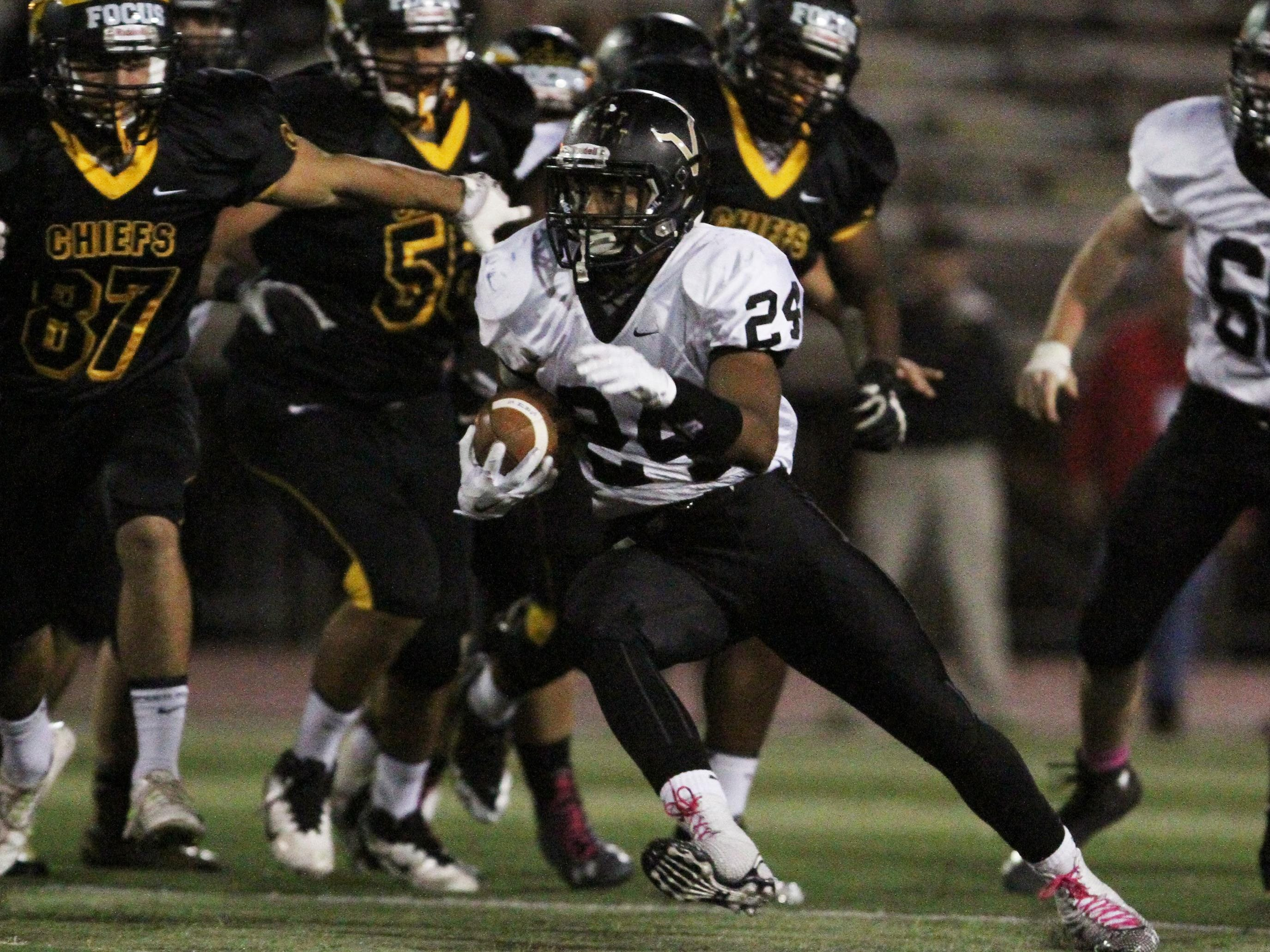 Action photos of No. 2 South Brunswick at No. 1 Piscataway in huge GMC football game at Piscataway High School.South Brunswick's # 24- Phil Campbell looks for running room during the 1st half of play.On Friday October 31,2014Photo: Mark R. Sullivan/Staff Photographer