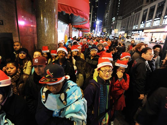 "(FILES): This November 24, 2011 file photo shows people standing in line outside Macy's department store in New York awaiting the midnight opening to begin the ""Black Friday"" shopping weekend.  Black Friday, the pinnacle of the US shopping year, comes on a Thursday this year. And even earlier.  Desperate for consumer bucks, US chain stores, some fighting for survival, are upping the ante this holiday shopping season with cutthroat discounts offered earlier than ever, and ever-longer opening hours. Giants like Walmart, Target and Best Buy, and online goliath Amazon, are squaring off with deals launched a week before traditional start of the Thanksgiving-Christmas shopping season.   AFP PHOTO / Files / Stan HONDASTAN HONDA/AFP/Getty Images"