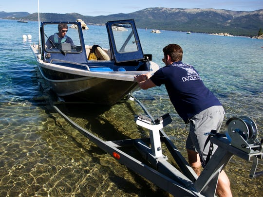 Andrew Cobourn, left, and Brian Limacher launch a Nevada State Park boat into Lake Tahoe at the Sand Harbor boat launch in Incline Village  on June 15 . The launch is expected to close around July 1  due to low water levels.