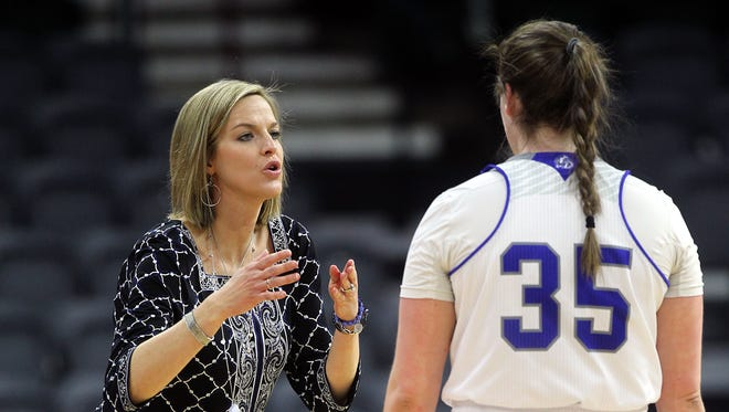 Drake head coach Jennie Baranczyk talks with Becca Jonas during the Bulldogs' game against Illinois State in the MVC Tournament at the iWireless Center in Moline, Ill. on Friday, March 10, 2017.
