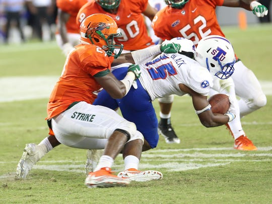 FAMU's Jakaris Wilson brings down TSU's Tyler Black during the Rattlers' 24-13 loss to Tennessee State. Wilson had nine tackles against the Tigers.