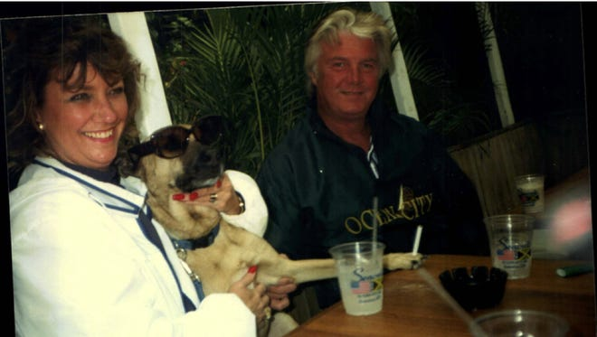 """Michael Funk, who died in September, with his wife, Marcia, and their dog, """"Hey,"""" during happier times. Michael Funk died after contracting Vibrio in Ocean City."""
