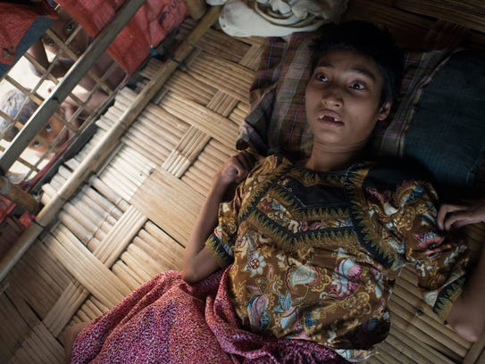 A girl who is sick with polio lying on the floor in