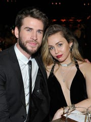 Honoree Liam Hemsworth and Miley Cyrus attend the 2019