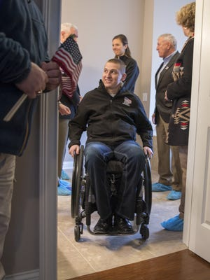 Marine Cpl. Zach Nelson checks out his new home in Noblesville, given to him and his wife, Kylie, by Homes for Our Troops, a Massachusetts-based nonprofit that helps severely wounded veterans. Nelson suffered a spinal injury in 2012, during a vehicle rollover while he was serving in Afghanistan.