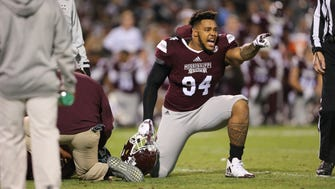 Mississippi State's Jeffery Simmons (94) yells at the Ole Miss sideline after Mississippi State's Nick Fitzgerald (7) was injured Thursday in Starkville.