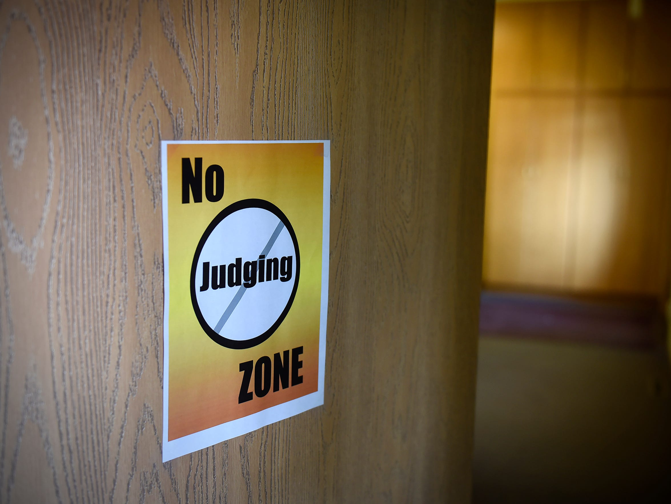A sign on a meeting room door at the Central Minnesota