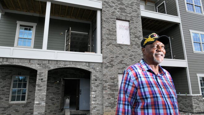 Willie Gentry, 68, stands in front of his future home at the Village at West Main Street near downtown Franklin on June 20, 2018. The housing development is one of two active affordable housing projects in Franklin.