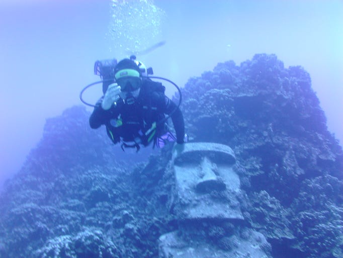 Tracy Hare of Phoenix scuba diving off Rapa Nui with