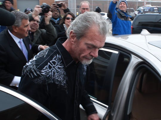 Jim Irsay, owner of the Indianapolis Colts, exits a Noblesville detention facility on the day after he was arrested on four felony counts in Carmel, Monday, March 17, 2014.
