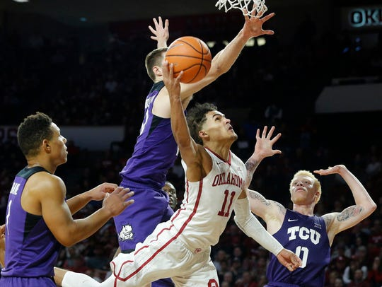 Oklahoma's Trae Young (11) makes a shot against TCU's