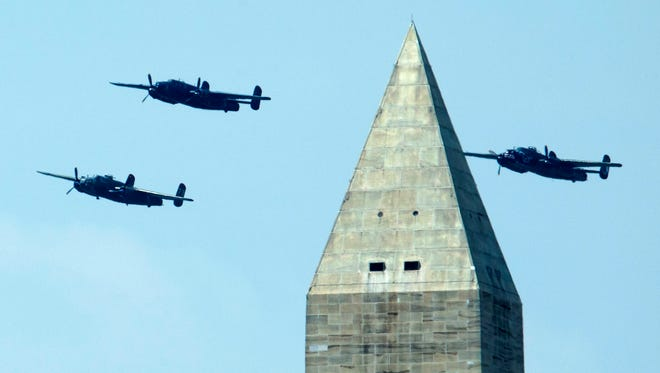 The North American B-25 Mitchell bombers fly the Doolittle Raid formation during a flyover over near the Washington Monument on May 8, 2015.