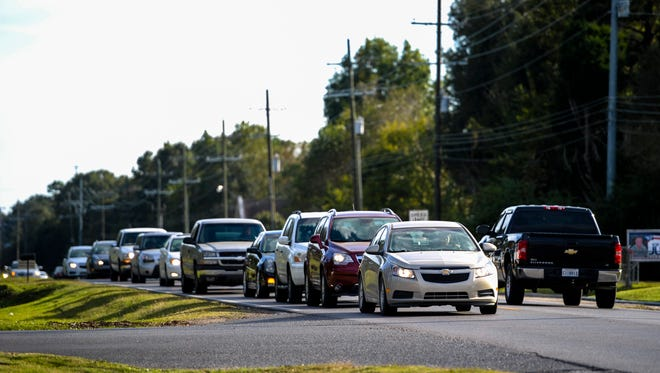 Vehicle traffic congests behind left-turning vehicle on Verot School Road in Lafayette, La., Tuesday, Oct. 28, 2014.  Paul Kieu, The Advertiser