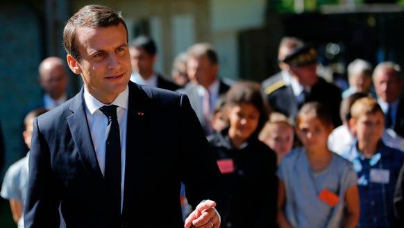 French President Emmanuel Macron gestures arrives for
