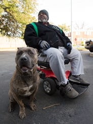 William Woods of Wilmington and his dog, Caesar, wait