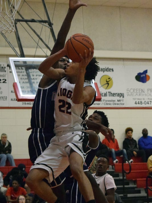 Tioga's Will Rue (22, front) goes for two against Northwood's Danny Slaughter (33, back) Tuesday.