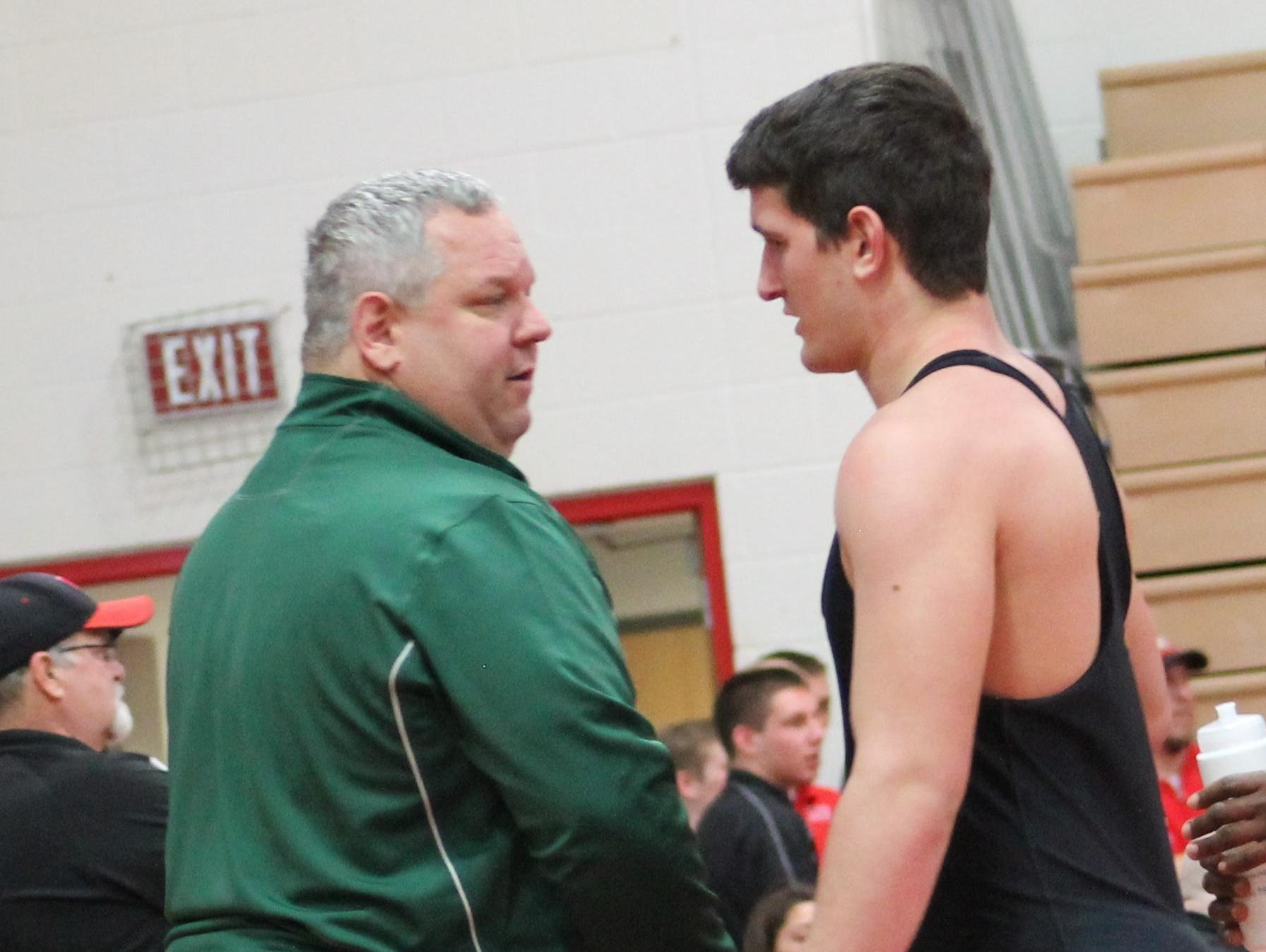 Sycamore's Gary Traub is congratulated by his father, John, after a victory last season.