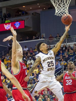 Murray State's Byron Hawkins lays up a shot as Belmont's Tyler Hadden defends during the Ohio Valley Conference championship game.