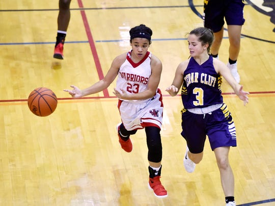 Susquehannock's Jayla Galbreath passes the ball against Cedar Cliff's Emily Esser in the second half of the championship game in Central York's Panther Holiday Classic Tournament Friday, Dec. 29, 2017, at Central York. Susquehannock defeated Cedar Cliff 47-35 to win the tournament.