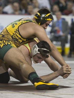 Dean Drugac of Morris Knolls (top) wrestles Kevin Mulligan of Bergen Catholic in a 195-pound bout during the NJSIAA Tournament in Atlantic City, NJ on March 6, 2016