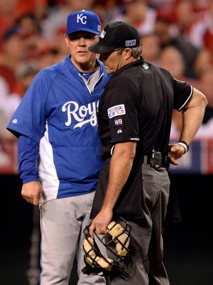 Royals manager Ned Yost  discusses a call with an umpire in the ALDS.