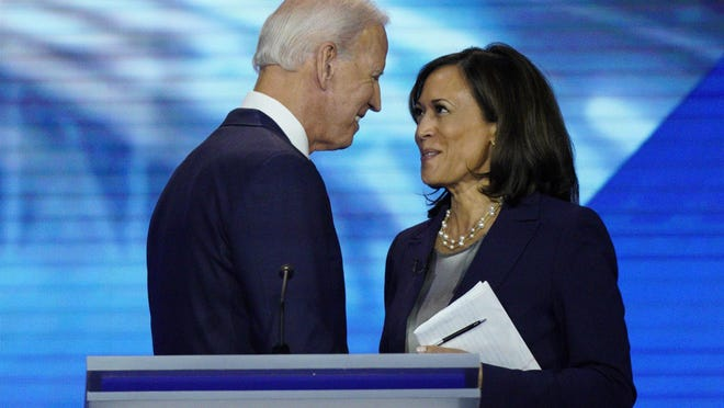 Democratic presidential candidates former Vice President Joe Biden, left, and Sen. Kamala Harris, D-Calif. shake hands Sept. 12, 2019, after a Democratic presidential primary debate hosted by ABC at Texas Southern University in Houston. Biden has selected Harris as his vice presidential pick.