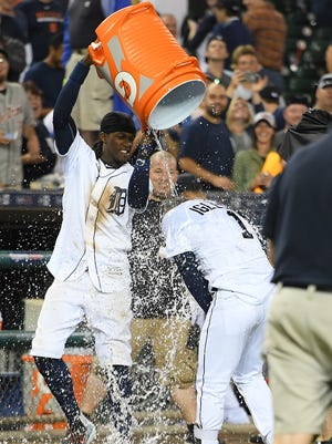 Tigers centerfielder Cameron Maybin, left, douses shortstop Jose Iglesias after Iglesias hit a walkoff RBI-single in the ninth inning of the Tigers' 3-2 win over the Astros Saturday at Comerica Park.